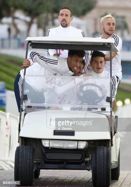 Kingsley Coman Javi Martinez James Rodriguez Franck Ribery and Rafinha drive in a golf cart on their way to a training session on day 2 of the FC...