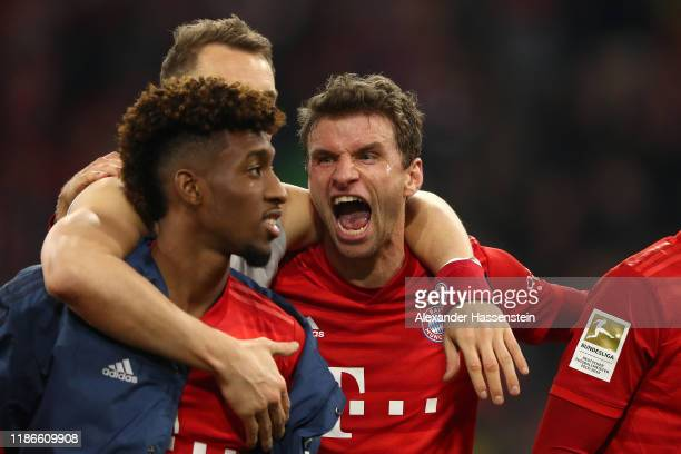 Kingsley Coman Manuel Neuer and Thomas Müller of FC Bayern Muenchen celebrate victory after winning the Bundesliga match between FC Bayern Muenchen...