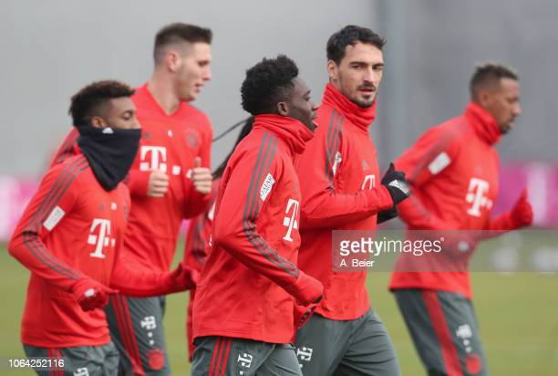 Kingsley Coman Niklas Suele Alphonso Davies Mats Hummels and Jerome Boateng of FC Bayern Muenchen warm up at the club's Saebener Strasse training...