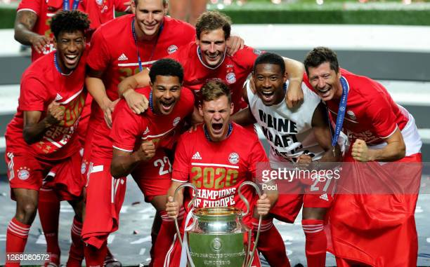 Kingsley Coman, Niklas Suele, Serge Gnabry, Joshua Kimmich, Leon Goretzka, David Alaba, and Robert Lewandowski of FC Bayern Munich celebrate with the...