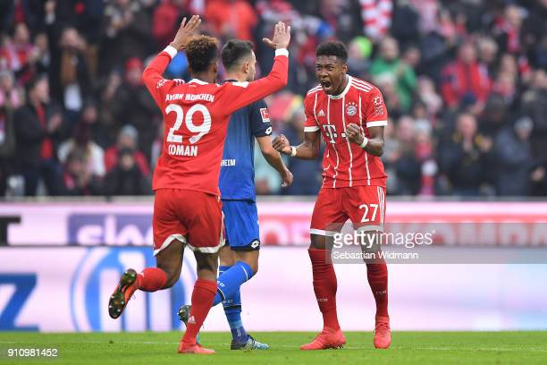Kingsley Coman of Bayern Muenchen and David Alaba of Bayern Muenchen celebrate after Robert Lewandowski of Bayern Muenchen scored a goal to make it...