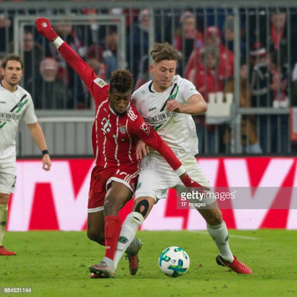 Kingsley Coman of Bayern Muenchen and Niclas Fuellkrug of Hannover battle for the ball during the Bundesliga match between FC Bayern Muenchen and...