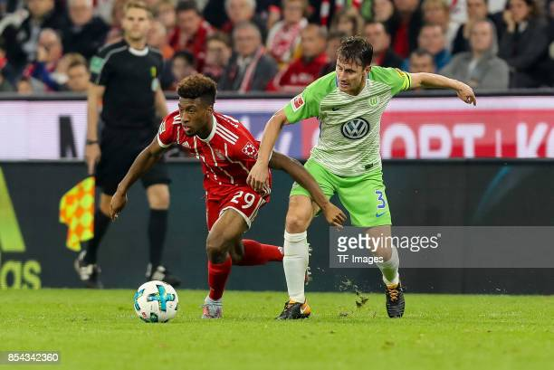 Kingsley Coman of Bayern Muenchen and Paul Johannes Gerardus Verhaegh of Wolfsburg battle for the ball during the Bundesliga match between FC Bayern...