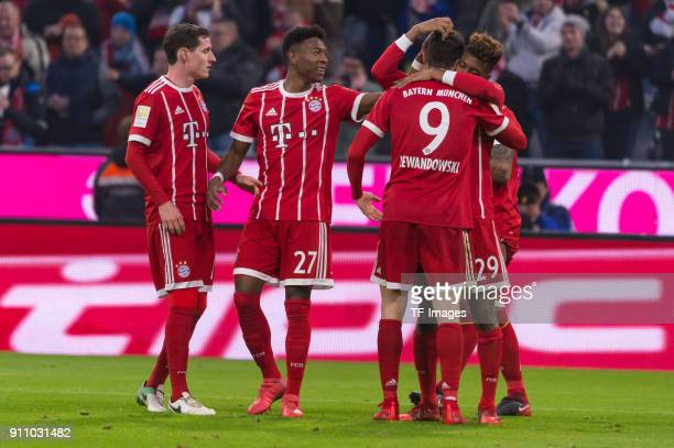 Kingsley Coman of Bayern Muenchen celebrates after scoring his team`s third goal with team mates during the Bundesliga match between FC Bayern...