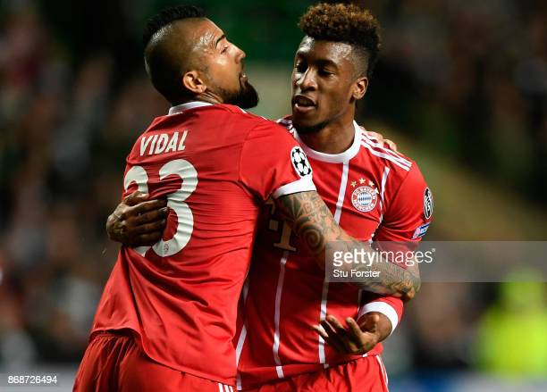 Kingsley Coman of Bayern Muenchen celebrates scoring his side's first goal with Arturo Vidal of Bayern Muenchen during the UEFA Champions League...