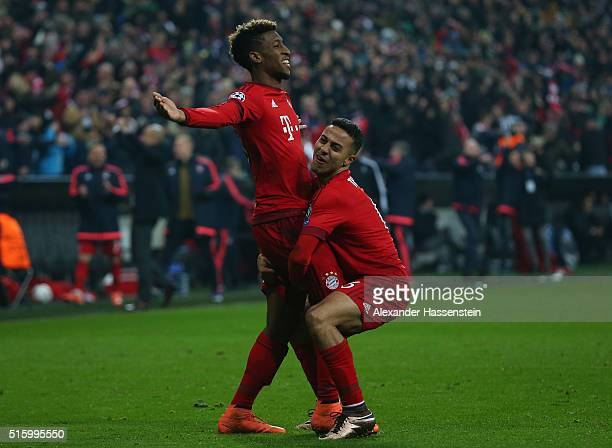 Kingsley Coman of Bayern Muenchen celebrates scoring his team's fourth goal with his team mate Thiago Alcantara during the UEFA Champions League...