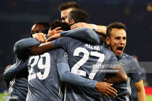 Kingsley Coman of Bayern Muenchen celebrates scoring his teams third goal of the game with team mates as Rafinha screams at the Ajax fans during the...