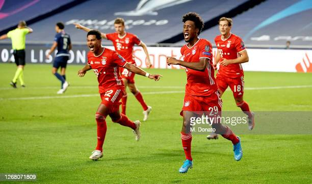 Kingsley Coman of Bayern Muenchen celebrates the first goal for his team with his teammates during the UEFA Champions League Final match between...