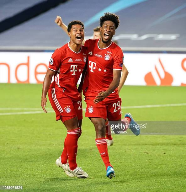 Kingsley Coman of Bayern Muenchen celebrates the first goal for his team with Serge Gnabry of Bayern Muenchen during the UEFA Champions League Final...
