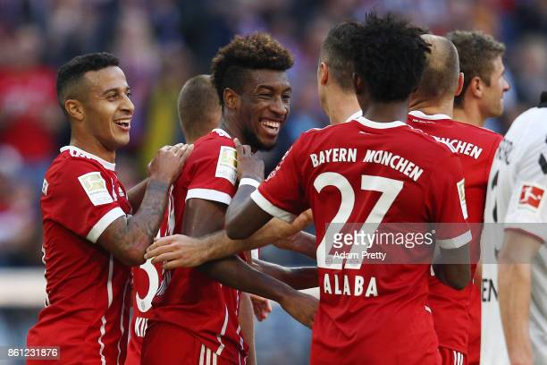 Kingsley Coman of Bayern Muenchen celebrates with his team after he scored his teams second goal to make it 20 during the Bundesliga match between FC...