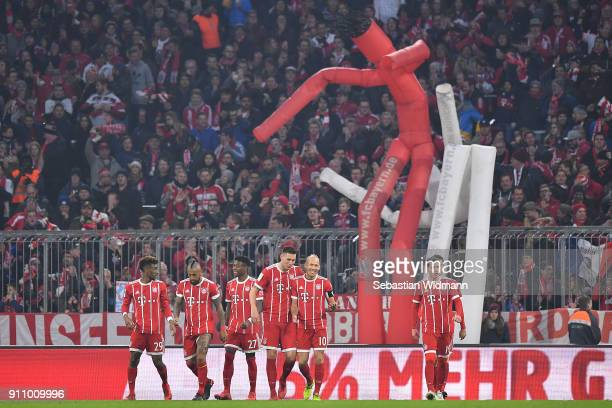 Kingsley Coman of Bayern Muenchen celebrates with his team after he scored a goal to make it 32 during the Bundesliga match between FC Bayern...