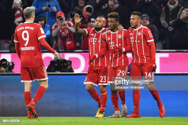 Kingsley Coman of Bayern Muenchen celebrates with his team mates after he scored a goal to make it 21 during the Bundesliga match between FC Bayern...
