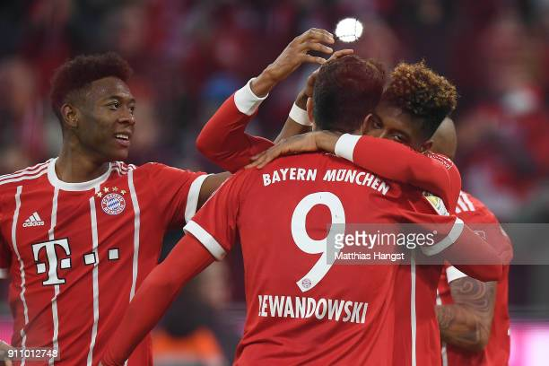 Kingsley Coman of Bayern Muenchen celebrates with Robert Lewandowski of Bayern Muenchen after he scored a goal to make it 32 during the Bundesliga...