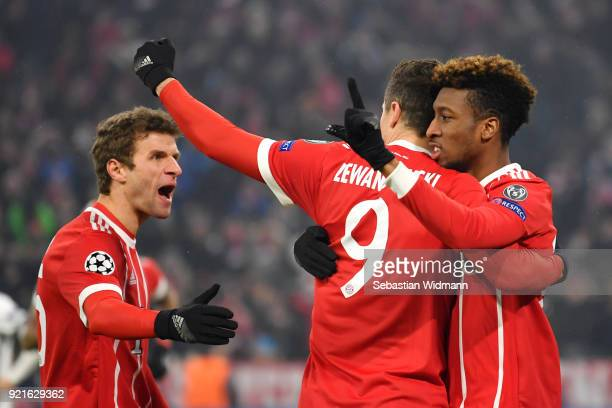 Kingsley Coman of Bayern Muenchen celebrates with teammate Robert Lewandowski after scoring his sides second goal during the UEFA Champions League...