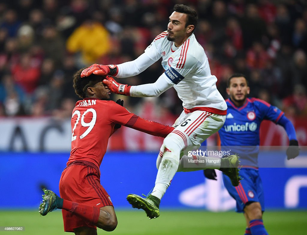 Kingsley Coman of Bayern Muenchen clashes with Roberto of Olympiacos after scoring his teams fourth goal during the UEFA Champions League group F match between FC Bayern Munchen and Olympiacos FC at the Allianz Arena on November 24, 2015 in Munich, Germany.