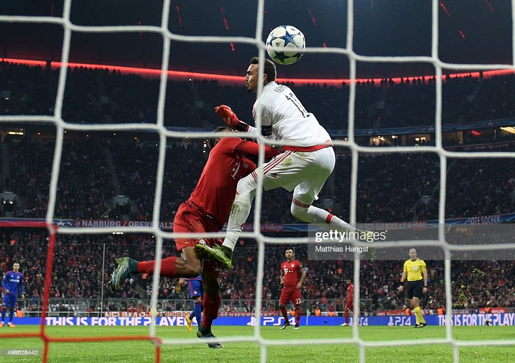 Kingsley Coman of Bayern Muenchen clashes with Roberto of Olympiacos as he scores his teams fourth goal during the UEFA Champions League group F match between FC Bayern Munchen and Olympiacos FC at the Allianz Arena on November 24, 2015 in Munich, Germany.
