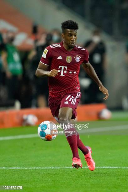 Kingsley Coman of Bayern Muenchen controls the ball during the Bundesliga match between Borussia Moenchengladbach and FC Bayern Muenchen at...