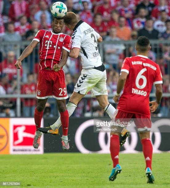 Kingsley Coman of Bayern Muenchen fights for the ball with Philipp Lienhart of Freiburg during the Bundesliga match between FC Bayern Muenchen and...
