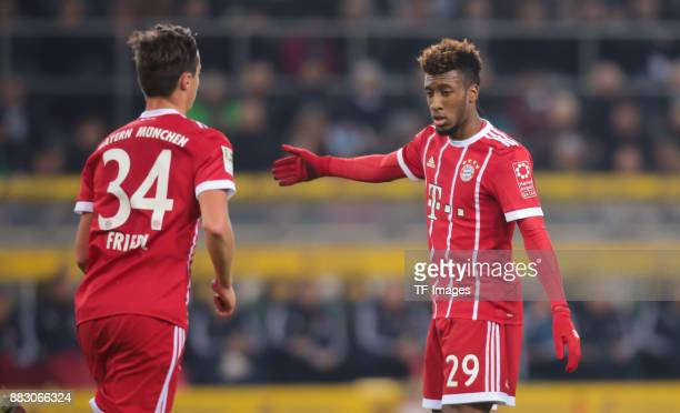 Kingsley Coman of Bayern Muenchen gestures and Marco Friedl of Bayern Muenchen looks on during the Bundesliga match between Borussia Moenchengladbach...