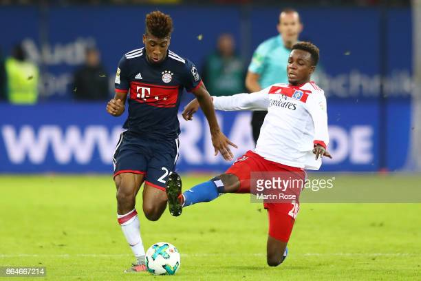 Kingsley Coman of Bayern Muenchen is challenged by Gideon Jung of Hamburg which results in a red card for Jung during the Bundesliga match between...