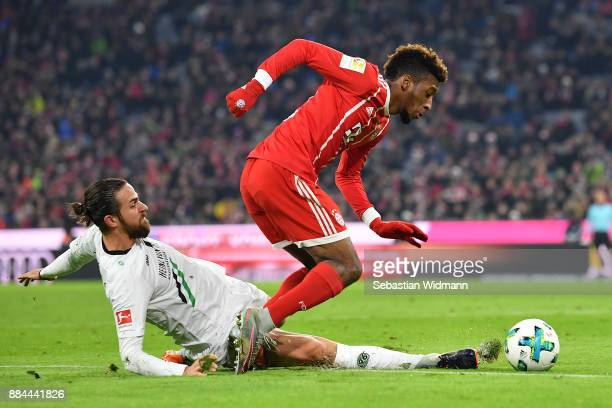 Kingsley Coman of Bayern Muenchen is fouled by Martin Harnik of Hannover that leads to a penalty for Muenchen during the Bundesliga match between FC...