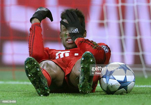 Kingsley Coman of Bayern Muenchen lies on the pitch after he scored a goal during the Champions League group F match between FC Bayern Muenchen and...