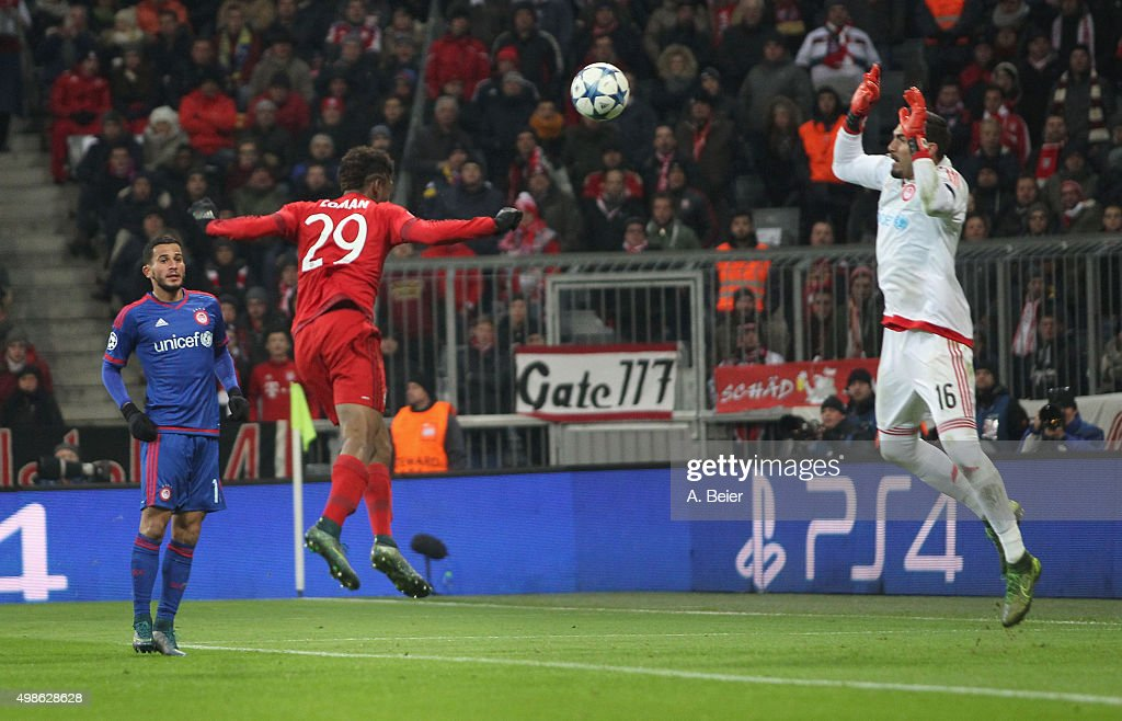 Kingsley Coman (C) of Bayern Muenchen scores a goal against goalkeeper Roberto of Olympiacos FC during the Champions League group F match between FC Bayern Muenchen and Olympiacos FC on November 24, 2015 in Munich, Germany.