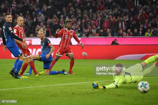 Kingsley Coman of Bayern Muenchen scores a goal past Oliver Baumann of Hoffenheim to make it 32 during the Bundesliga match between FC Bayern...