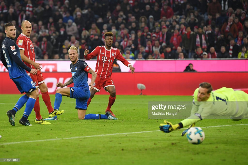 Kingsley Coman of Bayern Muenchen (2nd right) scores a goal past Oliver Baumann of Hoffenheim to make it 3:2 during the Bundesliga match between FC Bayern Muenchen and TSG 1899 Hoffenheim at Allianz Arena on January 27, 2018 in Munich, Germany.