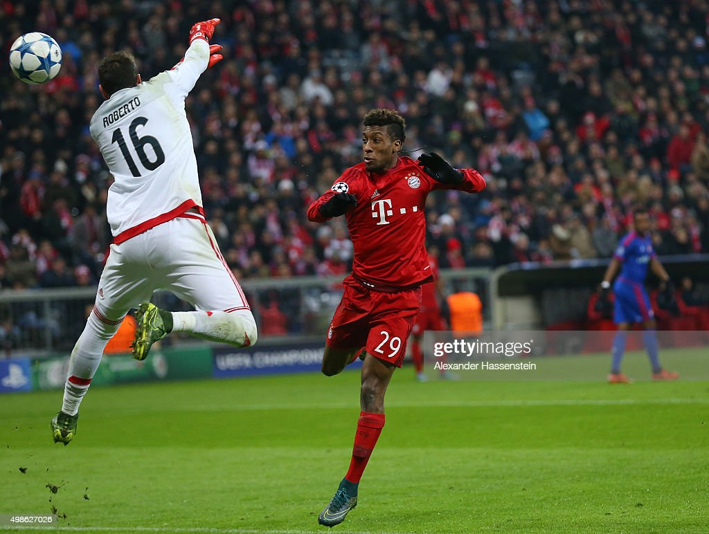 Kingsley Coman of Bayern Muenchen scores his teams fourth goal past Roberto of Olympiacos during the UEFA Champions League group F match between FC Bayern Munchen and Olympiacos FC at the Allianz Arena on November 24, 2015 in Munich, Germany.