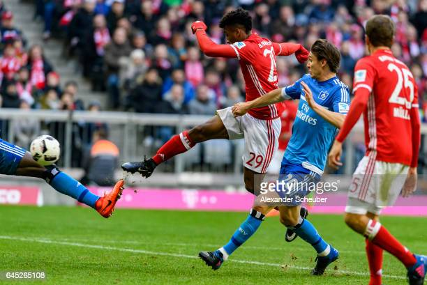 Kingsley Coman of Bayern Muenchen scores the seventh goal for his team during the Bundesliga match between Bayern Muenchen and Hamburger SV at...