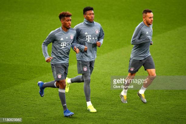 Kingsley Coman of Bayern Munich and David Alaba of Bayern Munich warm up during the FC Bayern Muenchen Training Session ahead of the UEFA Champions...