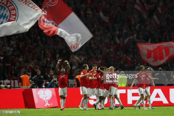 Kingsley Coman of Bayern Munich celebrates after scoring his team's second goal during the DFB Cup final between RB Leipzig and Bayern Muenchen at...