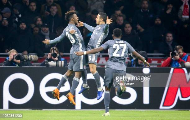 Kingsley Coman of Bayern Munich celebrates his goal with Thiago Alcantara during the UEFA Champions League Group E match between Ajax and FC Bayern...