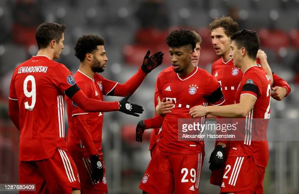 Kingsley Coman of Bayern Munich celebrates his sides second goal which came from a Max Woeber of RB Salzburg scored a own goal with Serge Gnabry,...