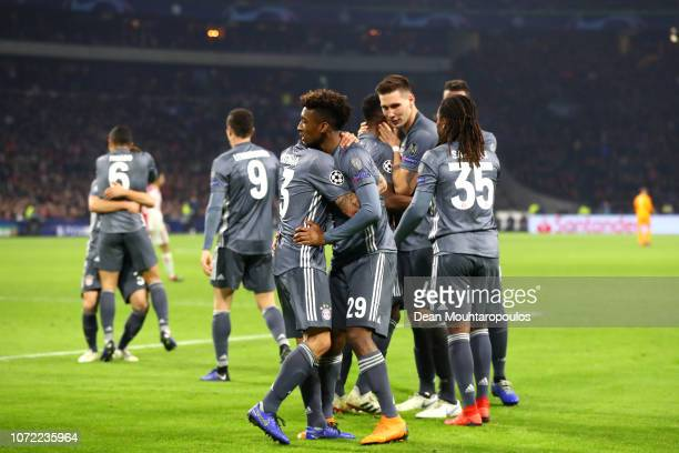 Kingsley Coman of Bayern Munich celebrates with team mates after scoring his sides third goal during the UEFA Champions League Group E match between...