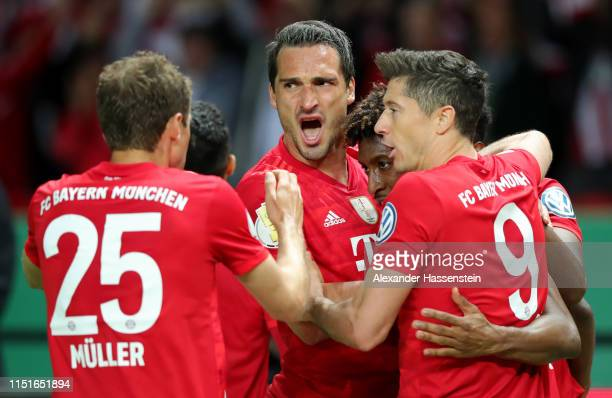 Kingsley Coman of Bayern Munich celebrates with teammates after scoring his team's second goal during the DFB Cup final between RB Leipzig and Bayern...