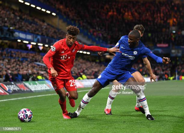 Kingsley Coman of Bayern Munich is closed down by Antonio Rudiger of Chelsea during the UEFA Champions League round of 16 first leg match between...