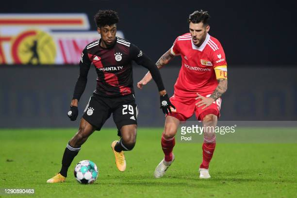 Kingsley Coman of Bayern Munich is put under pressure by Christopher Trimmel of 1.FC Union Berlin during the Bundesliga match between 1. FC Union...