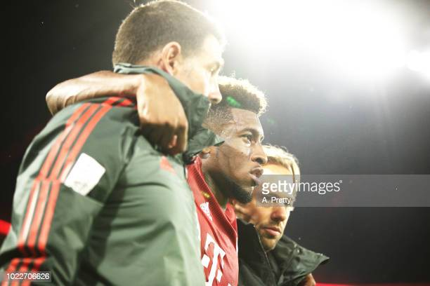 Kingsley Coman of Bayern Munich is taken off injured during the Bundesliga match between FC Bayern Muenchen and TSG 1899 Hoffenheim at Allianz Arena...