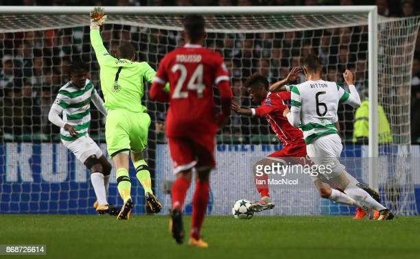 Kingsley Coman of Bayern Munich runs through to score the opening goal during the UEFA Champions League group B match between Celtic FC and Bayern...