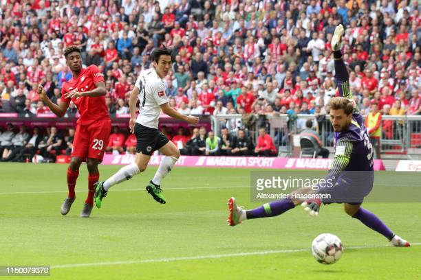 Kingsley Coman of Bayern Munich scores his team's first goal during the Bundesliga match between FC Bayern Muenchen and Eintracht Frankfurt at...