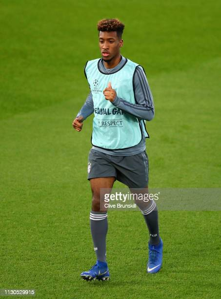 Kingsley Coman of Bayern Munich warms up during the FC Bayern Muenchen Training Session ahead of the UEFA Champions League Round of 16 First Leg...