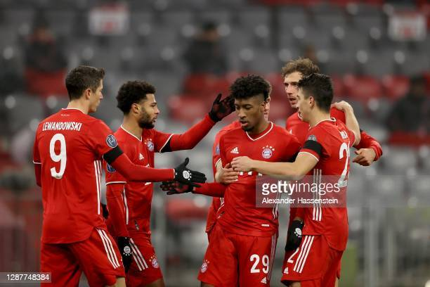 Kingsley Coman of FC Bayern München celebrates scoring the 2nd team goal with his team mates during the UEFA Champions League Group A stage match...