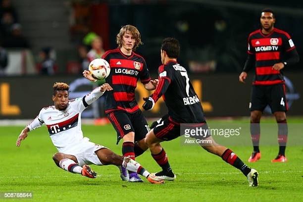 Kingsley Coman of FC Bayern Muenchen battles for the ball with Tin Jedvaj and Javier Hernandez of Bayer Leverkusen during the Bundesliga match...