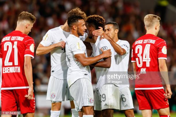 Kingsley Coman of FC Bayern Muenchen celebrates after scoring his team's second goal during the DFB Cup first round match between Energie Cottbus and...
