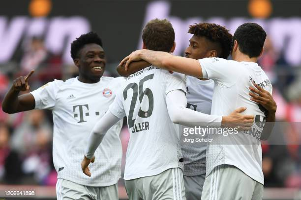 Kingsley Coman of FC Bayern Muenchen celebrates after scoring his sides second goal during the Bundesliga match between 1 FC Koeln and FC Bayern...
