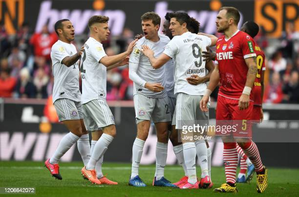 Kingsley Coman of FC Bayern Muenchen celebrates after scoring his sides second goal during the Bundesliga match between 1. FC Koeln and FC Bayern...