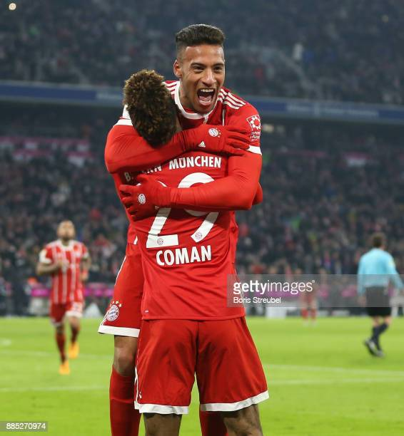 Kingsley Coman of FC Bayern Muenchen celebrates with team mates after scoring his team's second goal during the Bundesliga match between FC Bayern...