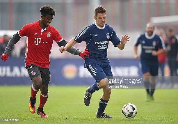 Kingsley Coman of FC Bayern Muenchen challenges Bert Callens of the Paulaner Soccer Team during the Paulaner Fan Dream Bavarian Battle Qualifier on...